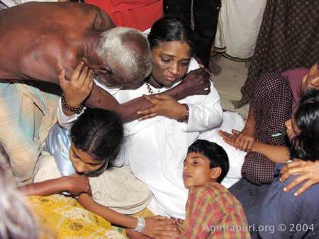 Amma consoles tsunami victims